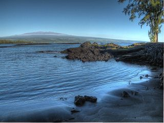 Hilo bungalow photo - View of Mauna Kea towering over the ocean from Richardson's Beach