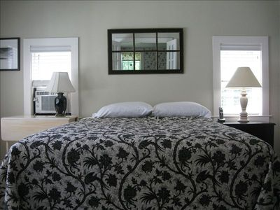 Master bedroom with a queen bed, a writing desk, dresser and a walk-in closet