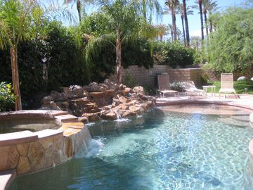 Rancho Mirage estate rental - Another photo of our Pool, Spa and waterfall, shows tanning pan in the pool.