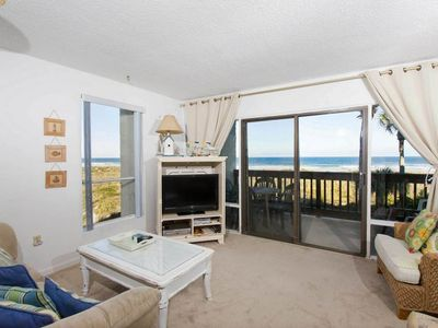 Stunning ocean views are just thru the sliders! - Our chic and comfy living room is a delightful space in which to relax, watch a show on the HDTV, or catch up with the gang on the adventures of the day