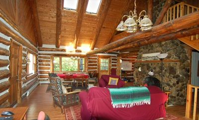 The spacious Great Room with huge stone fireplace and gas log insert