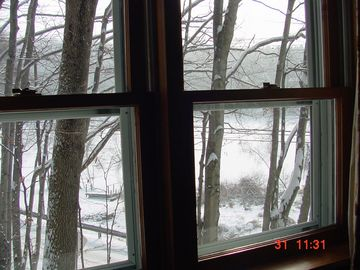 Living room side window view in winter.