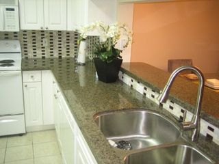 Sunny Isle condo photo - Fully Equipped Kitchen with Granite Countertops