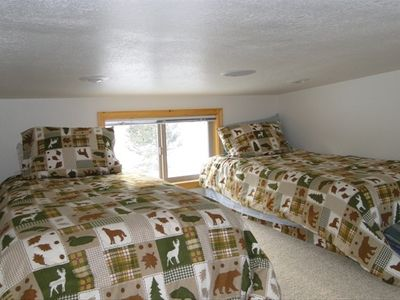One of the upstairs bedrooms with two twin beds.