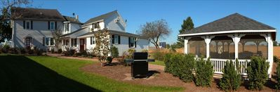 Lancaster farmhouse rental - Very spacious backyard with gazebo, grill and play area for kids