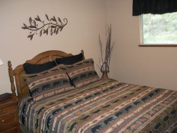 The Bear and Deer Bedroom features a queen bed