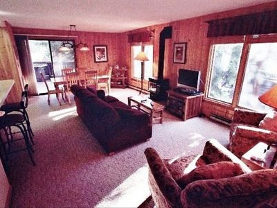 Living Room (flat screen TV, wood-burning fireplace, ski run view)