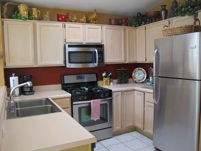 Fully equipped kitchen with new stainless appliances and mountain view