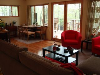 North Stonington house photo - Light,airy,comfortable LR/DR,bar stools at kit counter,big windows/door to deck