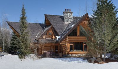 Exterior View of Majestic Log Home in Winter