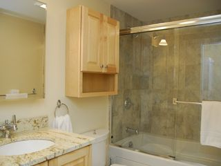 Portland condo photo - Promenade Place- Bathroom (Model) Jacuzzi Tub, Glass Doors, Tile & Granite