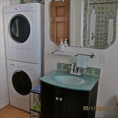 Tucson cottage photo - beautifully tiled bath with washer dryer.