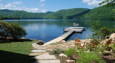 Private dock, patio with fire pit, walkway to lake.