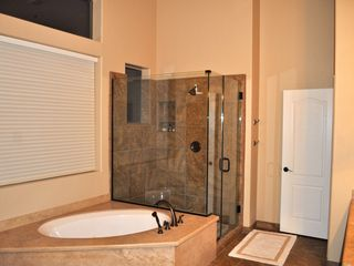 Scottsdale Troon house photo - view of the master bath free-standing glass shower and jet-spa tub!
