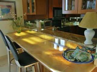Navarre Beach condo photo - Beautifully backlit onyx breakfast bar.