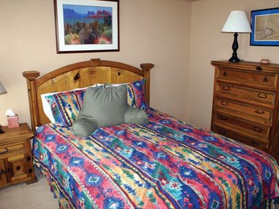 Main Level Queen Bedroom has private bathroom with shower/tub and walk-in closet
