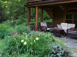 Woodstock cabin photo - Summer Flowers enhance the downstairs patio.