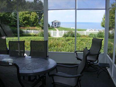 Screened in deck with great views of gazebo and Lake Michigan