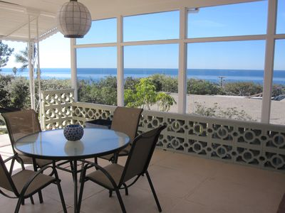 Patio and table with ocean view.