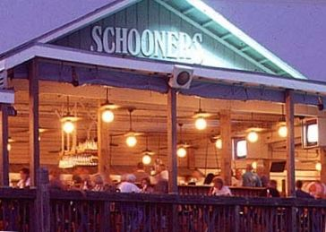 Nearby Schooners, where locals eat, dance, and celebrate the beach.
