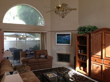 Living room with vaulted ceiling and fireplace
