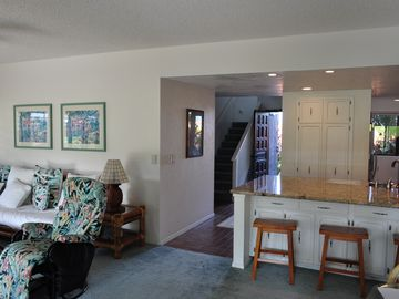 View of entry from Dining Room area. Kitchen and Living Room