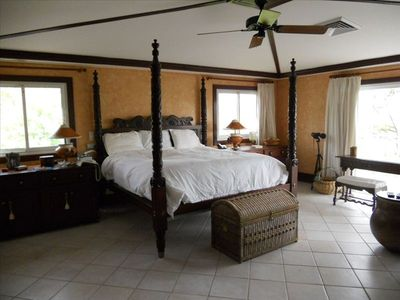 Spacious master suite opens onto private veranda, and master bath