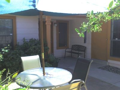 Private front entry with furnished courtyard including hot tub.