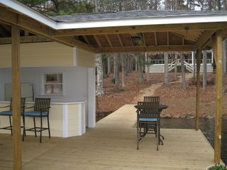 Lake Gaston house photo - Private, gentle wooded lot and awesome boathouse