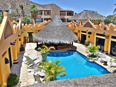 Great home with all guest suites surrounding the pool & palapa area