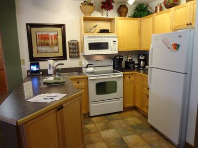 Kitchen with new appliances, Keurig brewer and Cuisinart carafe coffee maker.