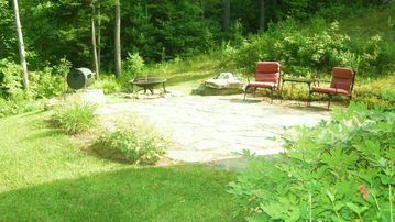 Patio with firepit, left view of yard