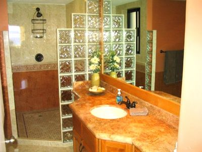 One of two large bathrooms with walk-in showers.