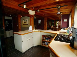 "Chilmark farmhouse photo - Here's the kitchen ""cockpit"" w/ 5 burner cook top and spice se"