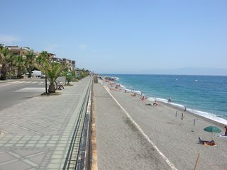 Taormina apartment photo - beach in front of the home in July