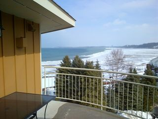Traverse City condo photo - Nice winter day. View from the balcony.