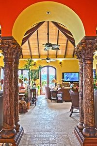 carved tropical columns lead into the spacious air conditioned great room