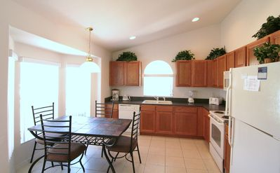 spacious kitchen with breakfast table