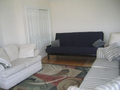 Scarborough Beach house rental - Living room with water view. Queen size futon for guests.