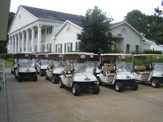 Calabash condo photo - golf carts ready to go