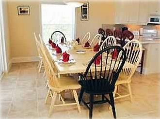 Dining Room with 10-person table plus 4 stools at granite-top breakfast bar.