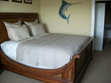 King size bed in the Master Bedroom. View of the Gulf of Mexico.