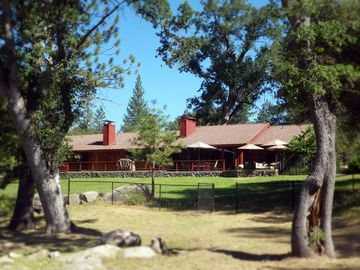 Ahwahnee house rental - View from the river, with a patio the length of the house to enjoy mtn. views.