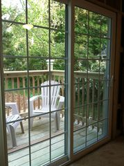 Sawyer house photo - sliding glass doors from the 3rd bedroom, 1st fl. Leads to deck and patio area