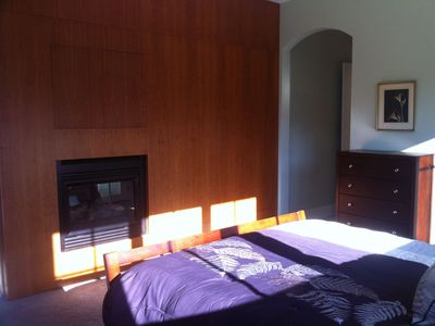 Master bedroom with two sided propane fireplace.