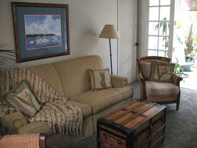 Family room - HDTV with tropical inspired patio to enjoy morning coffee or after
