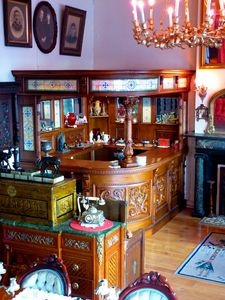 Newly installed 8-ft. x 6-ft. Victorian stained glass and hand carved wood bar!