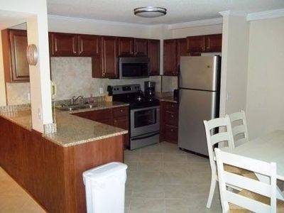 429B- Kitchen with NEW cabinets, granite countertops and stainless appliances