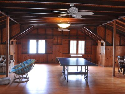 Bonus room above the garage with ping pong table, TV/DVD, and comfy seating.