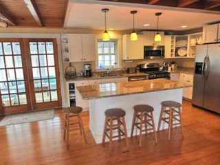 Katama house photo - Chef's Kitchen Features Granite Countertops, Breakfast Bar/Prep Island, Stainless Appliances & French Doors To Screened Porch